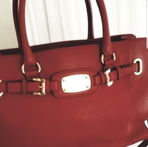 New Never used Micheal Kors Handbag tote red color